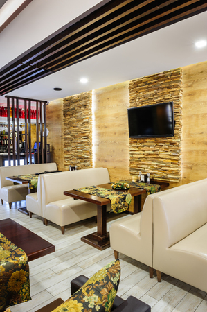 restaurant tables: Modern restaurant interior with tables and sofas