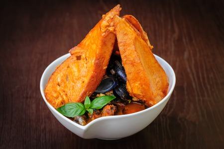 seafood soup: mussel and ather sea fruits soup with toasted bread