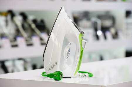 single shelf: electric iron at retail store shelf, defocused background