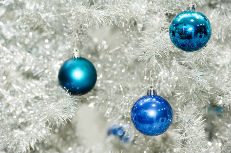 christmas tree ball: Blue baubles hanging on silver artificial christmas tree, good as background Stock Photo