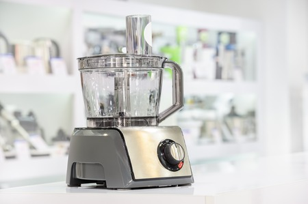 single shelf: single electric food processor at retail store shelf, defocused background Stock Photo