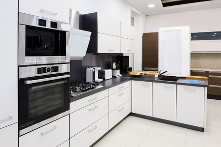 clean kitchen: Modern luxury hi-tek black and white kitchen interior, clean design Stock Photo
