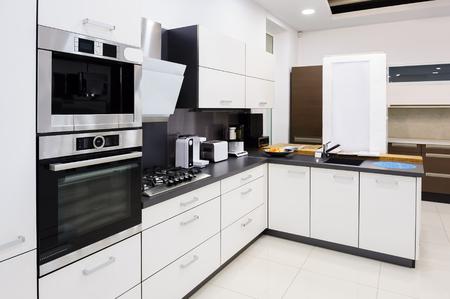furniture store: Modern luxury hi-tek black and white kitchen interior, clean design Stock Photo