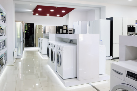 home related: Washing machines, refrigerators and other home related appliance or equipment in the retail store Stock Photo