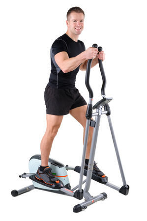 crosstrainer: young cute sporty woman doing exercises with elliptical trainer, on white background Stock Photo