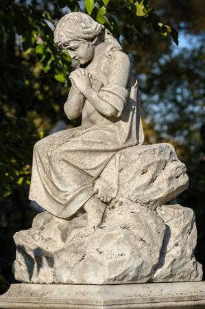 graves: Statue at Catholic cemetery in Chisinau, Republic of Moldova