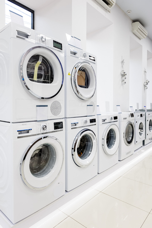 large: Row of washing mashines in appliance store