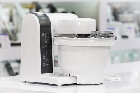 food processor: single electric food processor at retail store shelf, defocused background Stock Photo