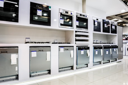 home related: Gas and electric ovens and other home related appliance or equipment in the retail store showroom Stock Photo