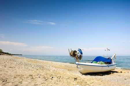 warm water fish: Fisher boats at the beach of Aegean sea, Greece Stock Photo