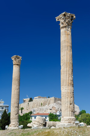 olympian: Olympeion, Ancient Temple of Olympian Zeus. Athens Greece. Acropolis at background.