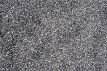 textured backgrounds: Dry black volcanic sand from Santorini texture background