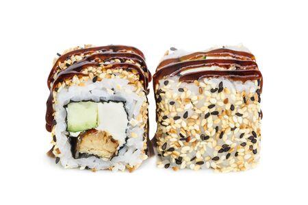 Uramaki maki sushi, two rolls isolated on white. Eeel with philadelphia, avocado, sesame and tempura