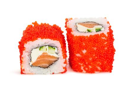 Uramaki maki sushi, two rolls isolated on white. Red tobiko, philadelphia cheese, avocado, salmon and nori Stock Photo