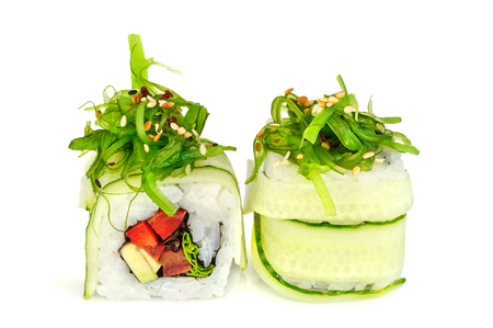 seaweed: Uramaki maki sushi, two rolls isolated on white. Philadelphia cheese, cucumber, tuna, bell pepper, avocado and sesame. Chuka seaweed with sesame on top.