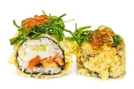 seabass: Tempura hot fried sushi maki with seabass, smoked eel, avocado and cream cheese, topped with chuka seaweed with red caviar, isolated on white background Stock Photo