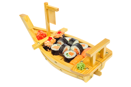 solated: Sushi set assorrted rolls ion ship shaped plate solated on white Stock Photo