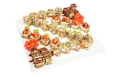 sushi set: Maki sushi set assorrted rolls isolated on white. Salmon, philadelphia cheese, avocado, eel, nori and sesame seeds Stock Photo