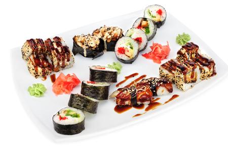 fruit plate: Maki and uramaki sushi set assorrted rolls isolated on white.