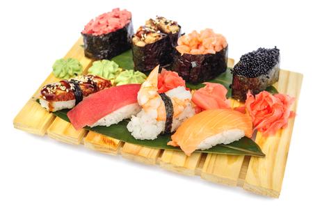 sushi set: Sushi set assorrted rolls on on bamboo board isolated on white