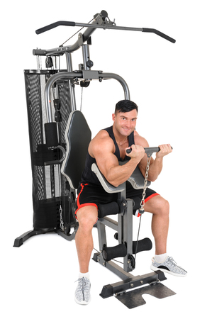 Handsome young man doing sitting biceps curl with t-bar workout, isolated on white background Stock Photo