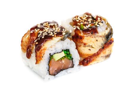 maki sushi: Uramaki maki sushi, two rolls isolated on white. Eeel with philadelphia, avocado, sesame and green tobico