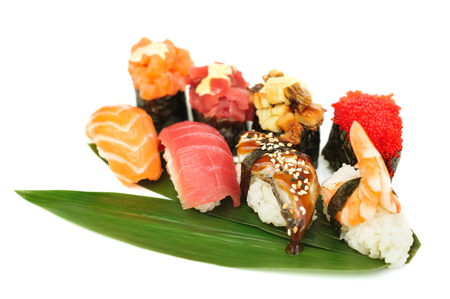 japanese sake: Sushi set assorrted rolls on solated on white background Foto de archivo