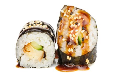 maki sushi: Maki sushi, two rolls isolated on white. Nori, rice, smoked eel, sesame seeds, teryaki sauce