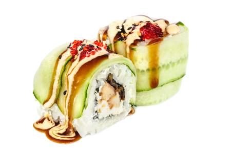 Uramaki maki sushi, two rolls isolated on white. Eeel with philadelphia, cucumber, sesame, red tobiko and tempura sauce