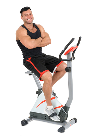 crosstrainer: young man doing exercises with elliptical cross trainer, isolated on white background