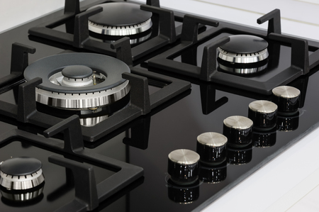 gas stove: Gas stove with stainless tray selling in appliance retail store, closeup Stock Photo