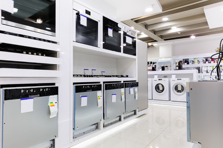 appliances: Gas and electric ovens and other home related appliance or equipment in the retail store showroom Stock Photo