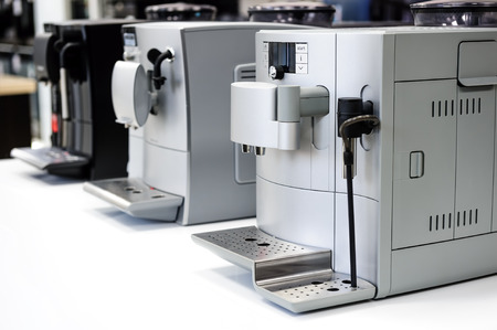 machines: row of modern coffee machines in appliances store