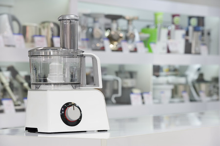 food processor: single electric food processor at retail store shelf, defocused background Stock Photo