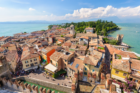 garda: Sirmione, province of Brescia, Lombardy, northern Italy, 15th August 2016: view to the old roofs of Sirmione town on lake Lago di Garda