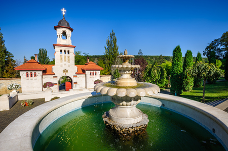 moldovan: Fountain and entrance gates with bell tower, at Curchi Orthodox Christian Monastery, Moldova Stock Photo