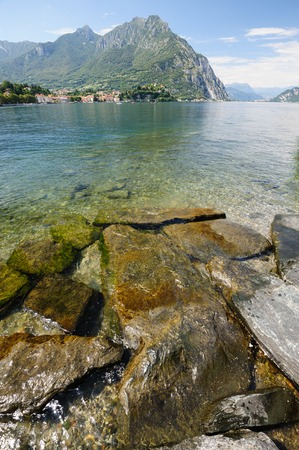 High mountains and village at other coast of Como lake, Lecco, italy Stock Photo