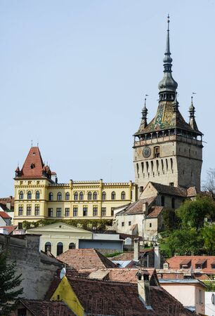 museum visit: View of the cityscape and architecture in Sighisoara town, Romania Stock Photo