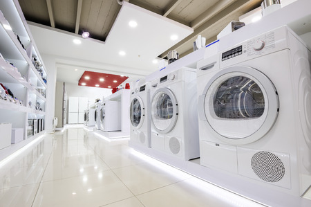 Washing machines, refrigerators and other home related appliance or equipment in the retail store showroom Stock Photo
