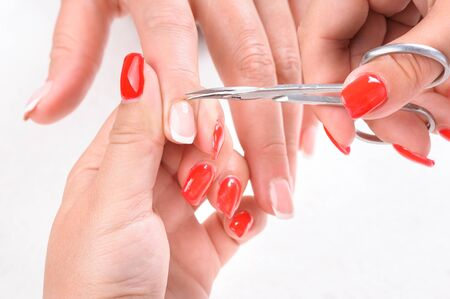 Nail salon, hands beauty treatment, cuticles cutting with cuticle pusher