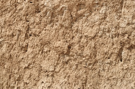 dryness: yellow red clay earthen wall texture background Stock Photo