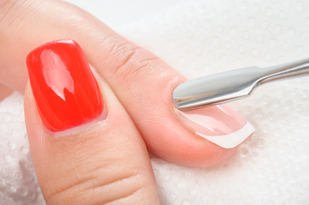 Nail salon, hands beauty treatment, cuticles care with metal cuticle pusher