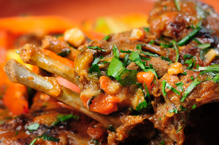 Roasted lamb carre covered with vegetable stew, selective focus Stock Photo