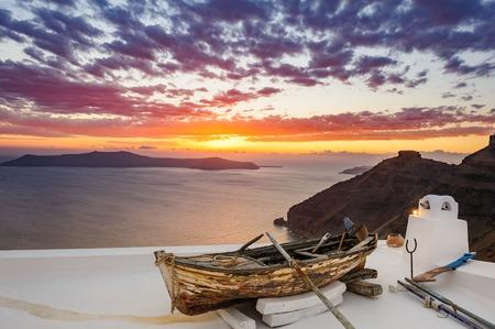 firostefani: Old wooden boat on roof in Firostefani, Santorini island, Greece