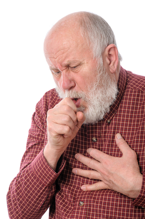 ilness: Senior man coughing, isolated on white