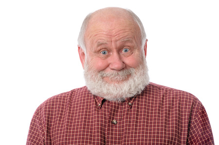 Senior man shows surprised smile facial expression, isolated on white photo