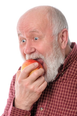 cheerfull: Cheerfull senior man eating the apple, isolated on white
