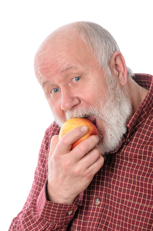 white man: Cheerfull senior man eating the apple, isolated on white