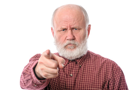 dictatorial: Senior man points the index finger to camera, isolated on white Stock Photo