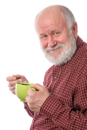 cheerfull: Cheerfull senior man with green cup, isolated on white